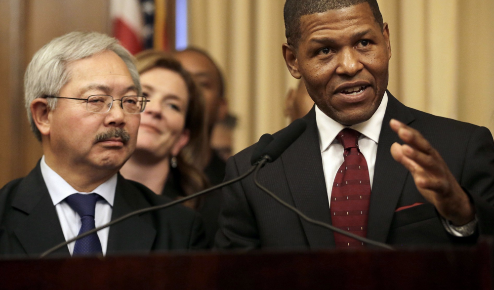 San Francisco Police Chief William Scott, right, speaks next to Mayor Ed Lee. CREDIT: AP Photo/Jeff Chiu