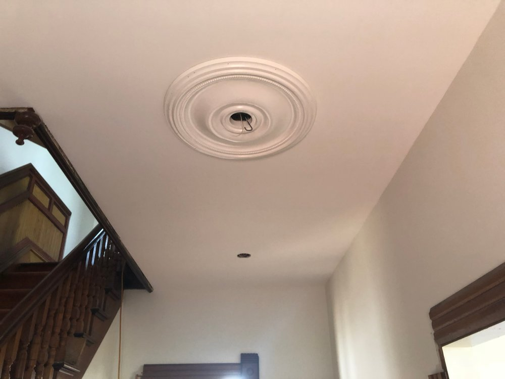 A false ceiling was removed and a fresh medallion was installed