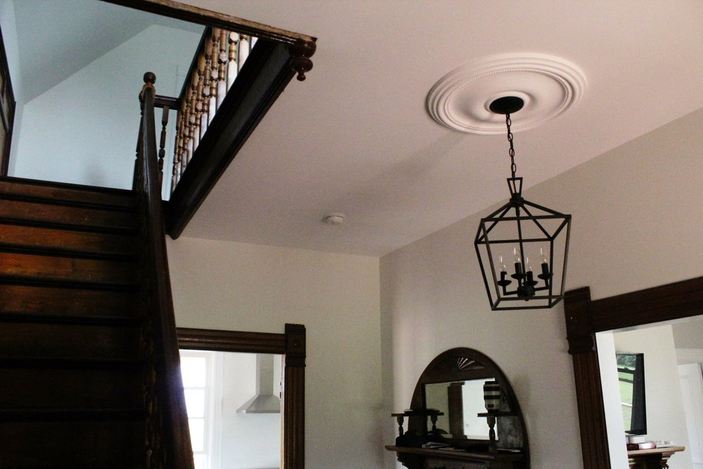 A new pendant light and moulding for the relocated entrance
