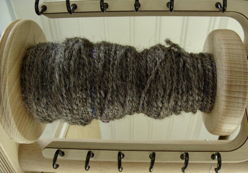 Jacob wool handspun single on bobbin