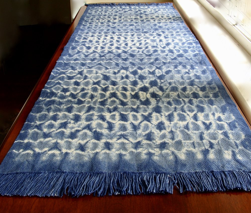 woven shibori table runner dyed in indigo bath