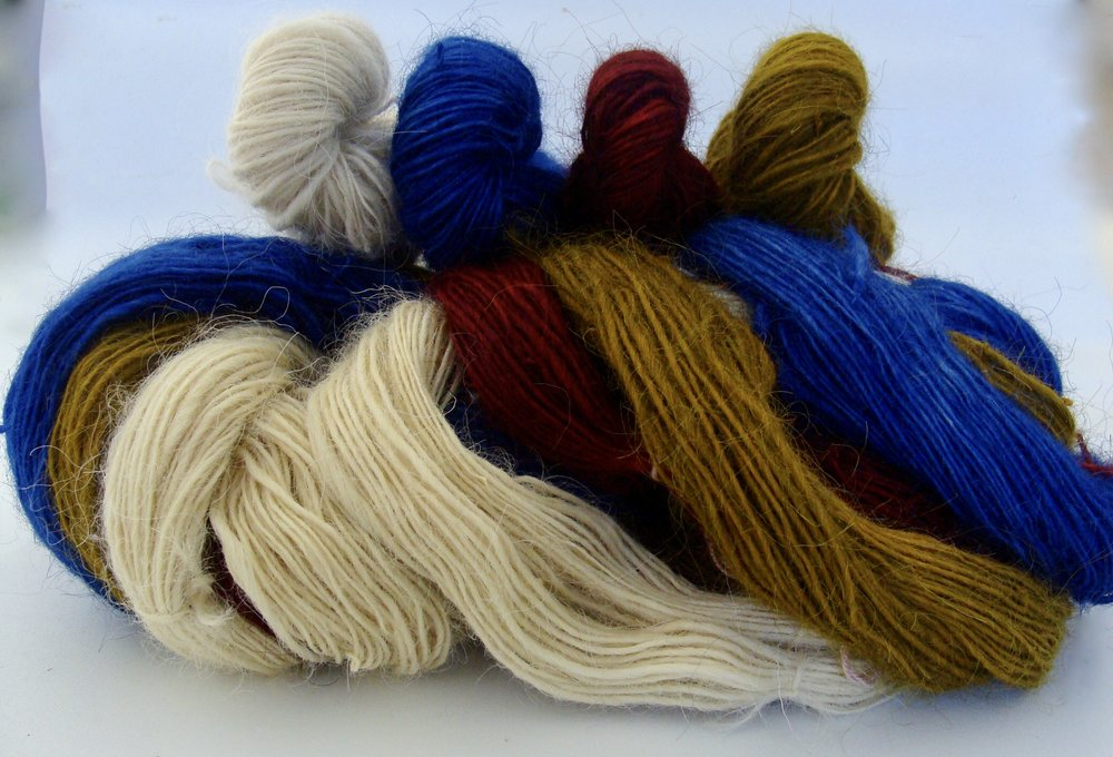 Hand-dyed Lincoln wool singles waiting to be 4-plyed.