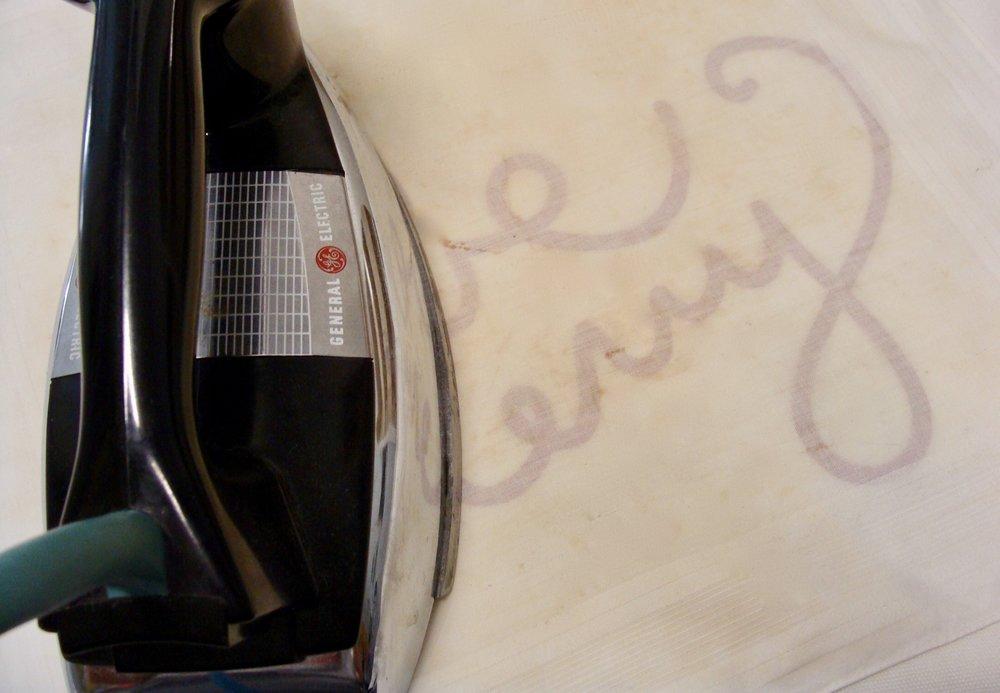 Heat pressing heat transfer vinyl design onto pillow