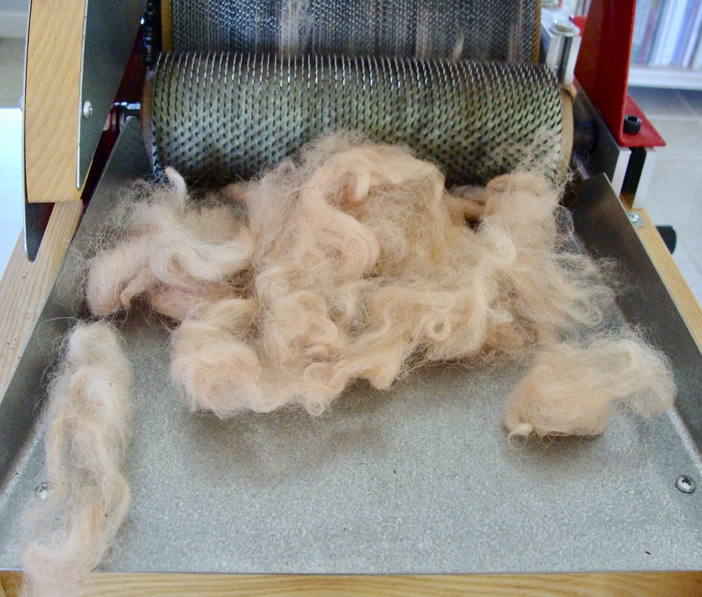 hand-dyed alpaca fleece and drum carder