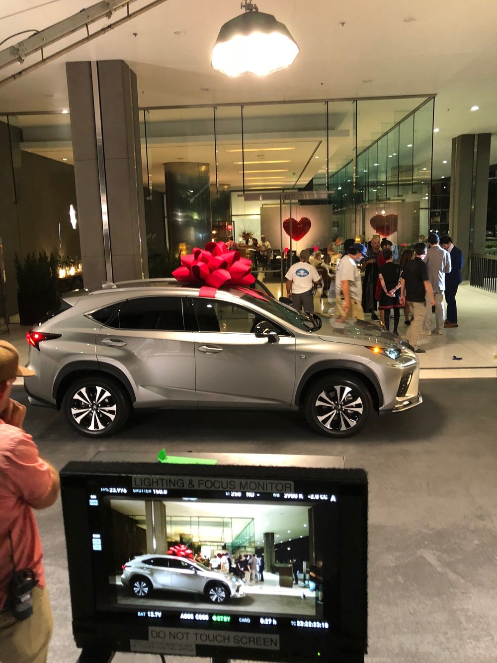 JOY - TVC 2 - Oooh, romantic Valentines day dates with gorgeous cars. The Lexus was lit from every angle in this shot. The Redback over head of course, for the bow. Two Redbacks in stealth mode in front to create for the………. and a back light for the actors.