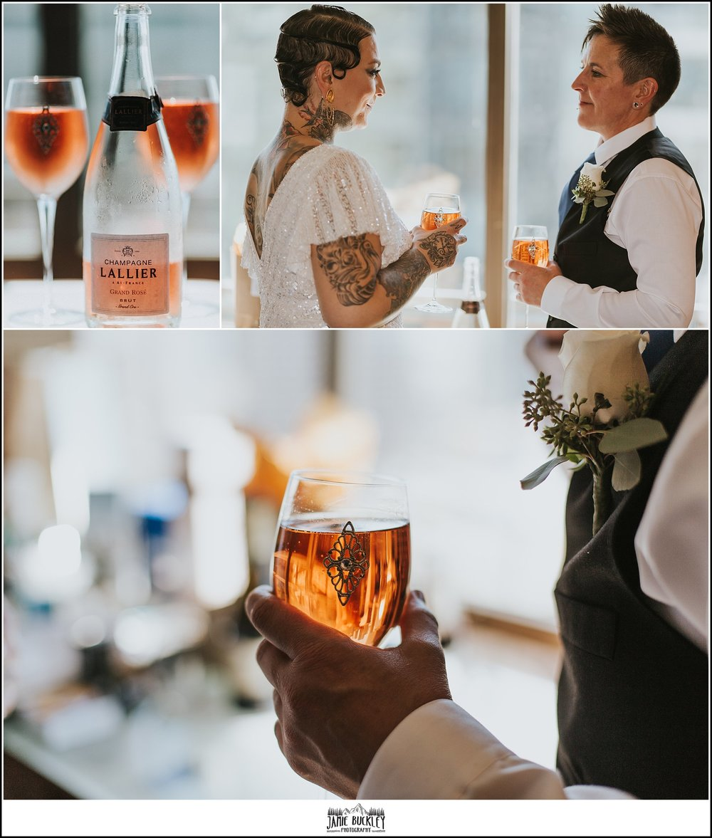 the brides sharing a glass of champagne