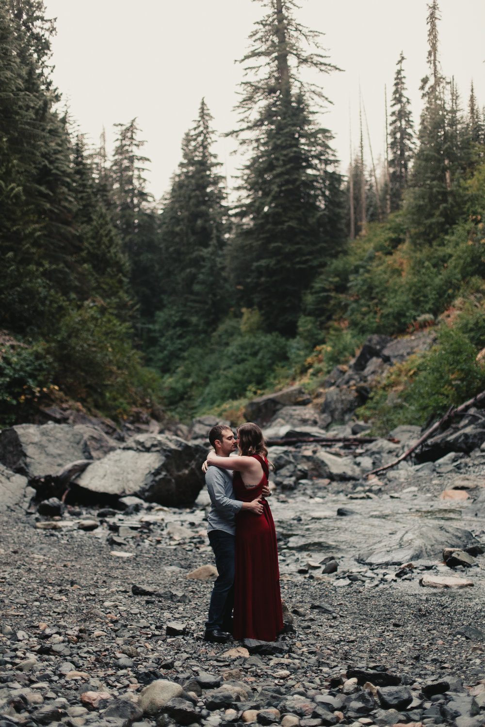 couple-standing-cuddling-in-river-gorge