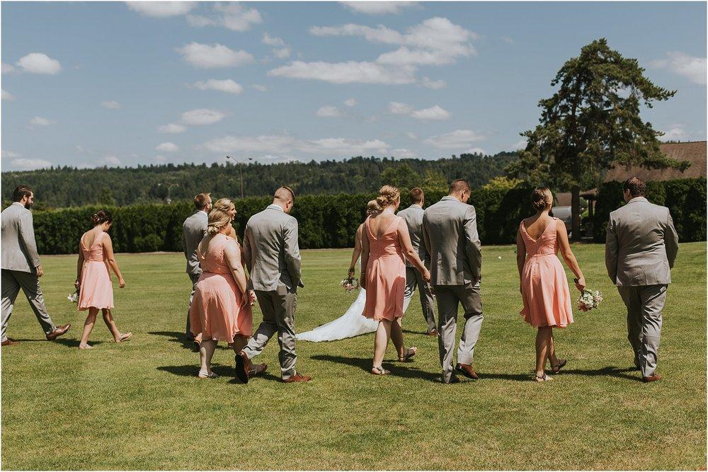 bridal party walking across lawn