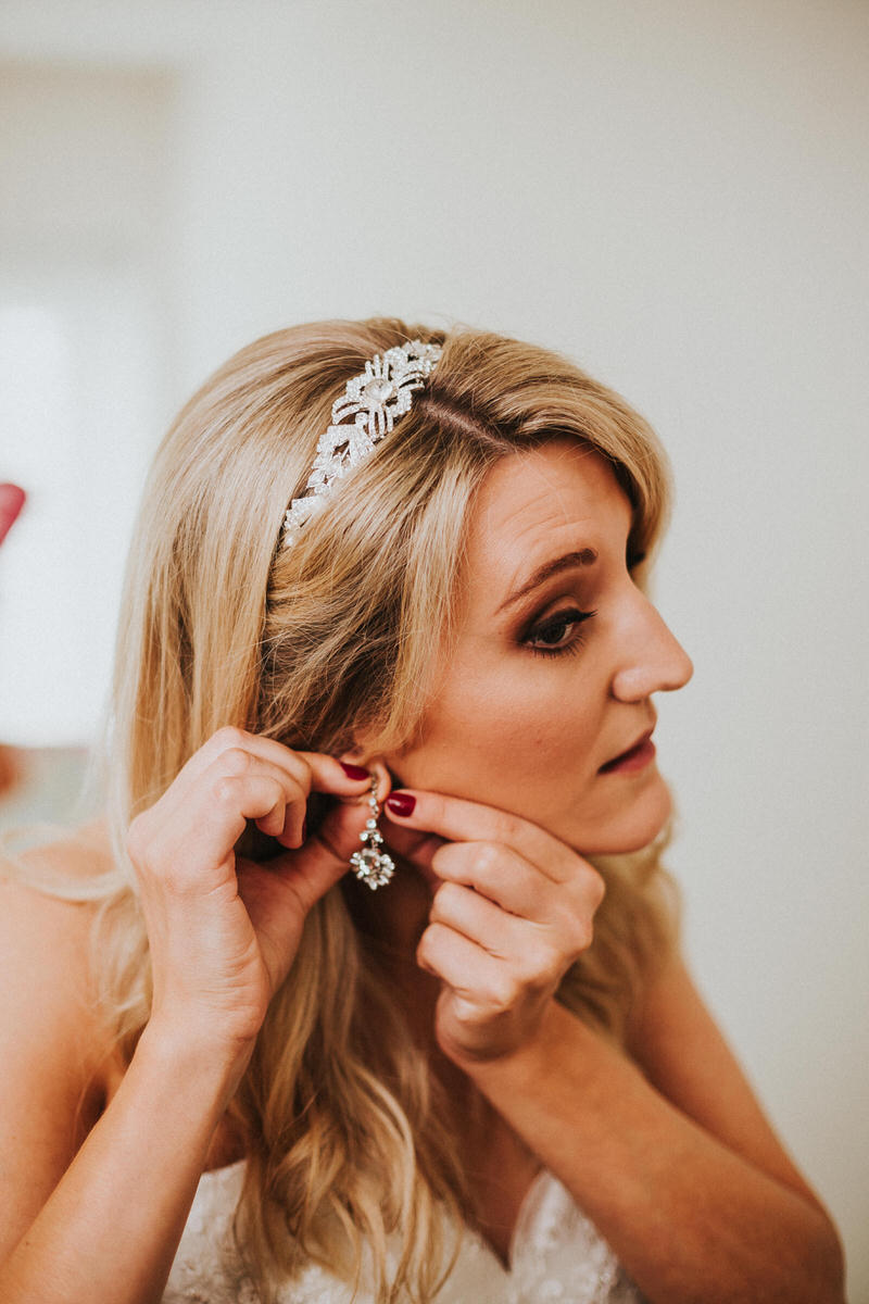 bride-putting-in-earring
