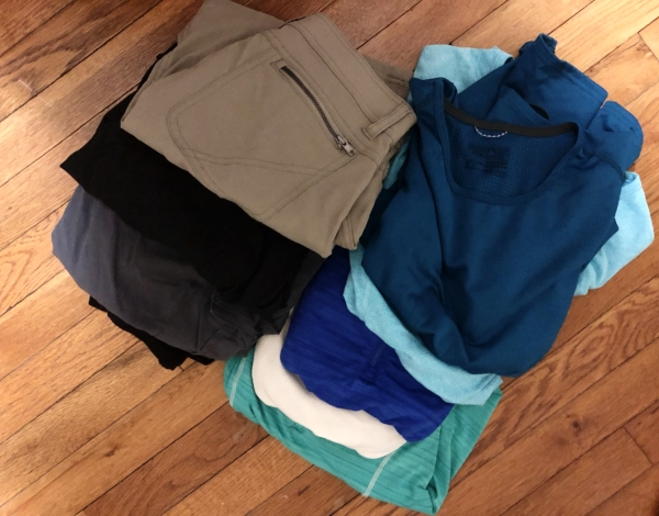 Pants and skirts (guys could consider kilts ;-)) and breathable tops (my favorites are Patagonia Capilene tops and shirts with silver in them for odor control). I pack my clothes in a dry bag or ziplock to make sure they stay dry.