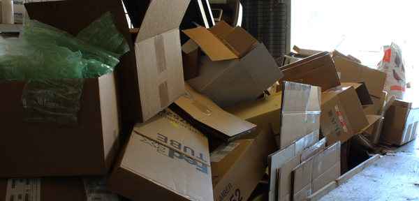 Mountain of empty boxes waiting to be packed