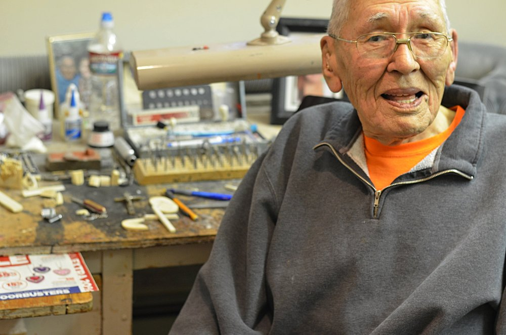 Kunnuk in his carving shop at his home in Anchorage.