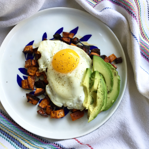 Roasted sweet potatoes with over-easy egg and avocado ~    YES, you can have sweet and regular potatoes!!!! Cut sweet potato into cubes and combine with a few glugs of olive oil, salt, pepper and thyme. Roast for 30-40 minutes at 400 degrees (I like them crispy). Top sweet potatoes with over-easy egg and fresh avocado. Season with salt, pepper and red pepper flake.