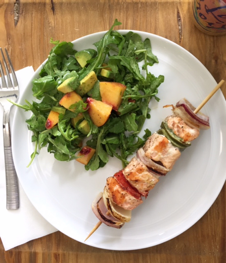 Simple salmon skewer with onions and red and green peppers. I just grilled this right on a stove-top griddle. And served with an arugula salad with avocado and peach... lemon vinaigrette.