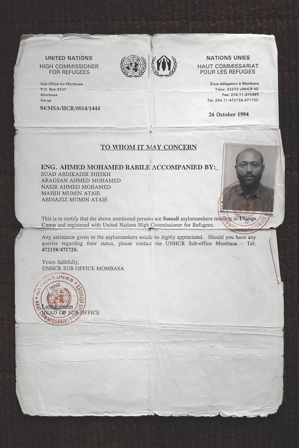 A document issued to my family by the UNHCR to prove that we were asylum seekers. The man in the photograph is my father.