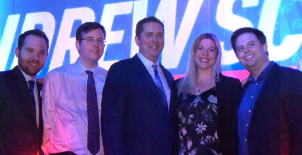 Conservative Leader Andrew Scheer, middle, poses with some members of his leadership campaign team at the Conservative leadership convention in May. From left, Marc-André Leclerc, Hamish Marshall (a former director for Rebel Media), Scheer, Kenzie Potter and Stephen Taylor. (CBC)