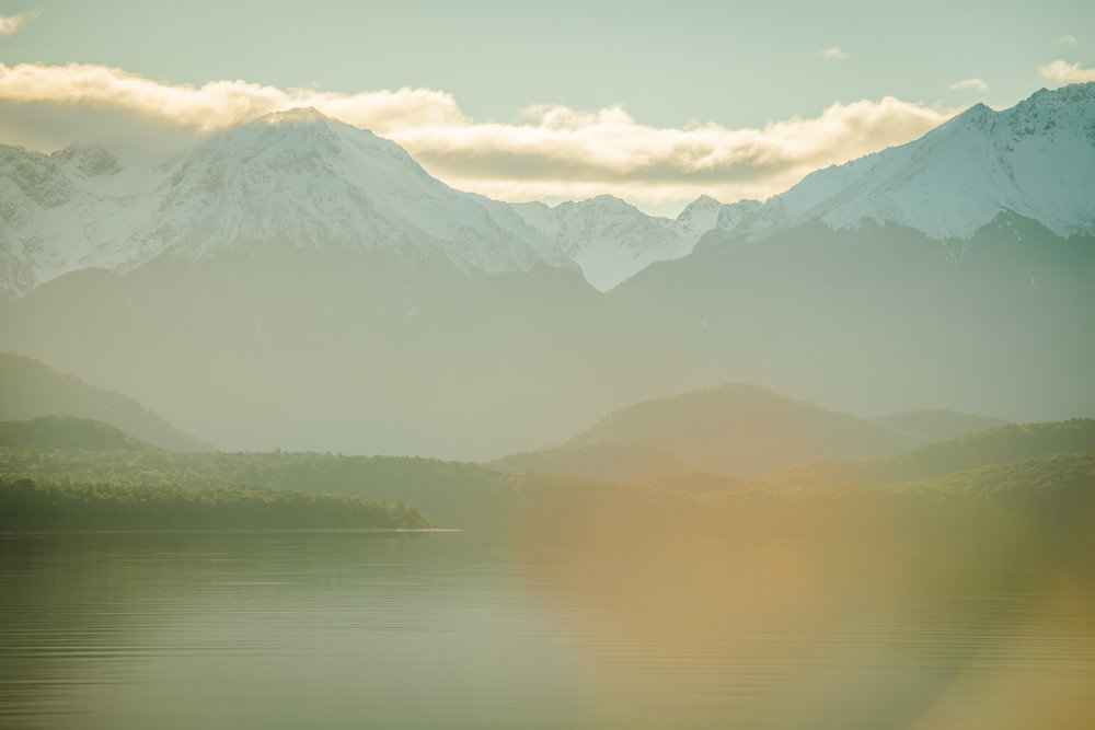 Light Flares Across Lake Te Anau as I was scoping out lines for the sunset shoot