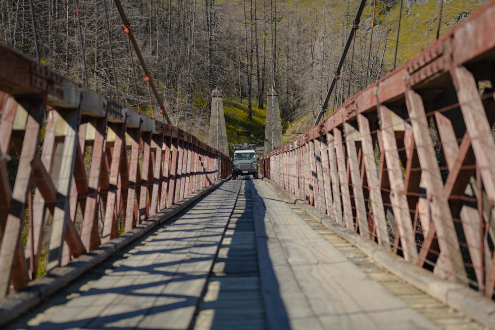 Driving across the Skipper Canyon Bridge