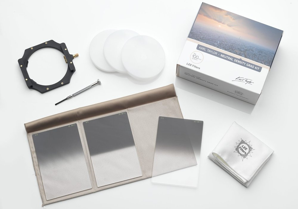 A Neutral Density Graduated Filter Kit. Top left: filter holder assembly and to its right, custom filter lens hoods. Bottom left: filters – soft, hard and medium edges.