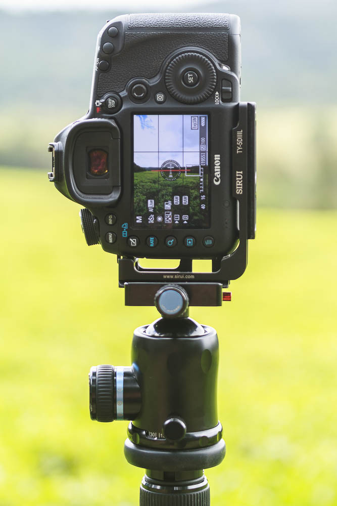 A camera in the upright portrait orientation using an L-bracket