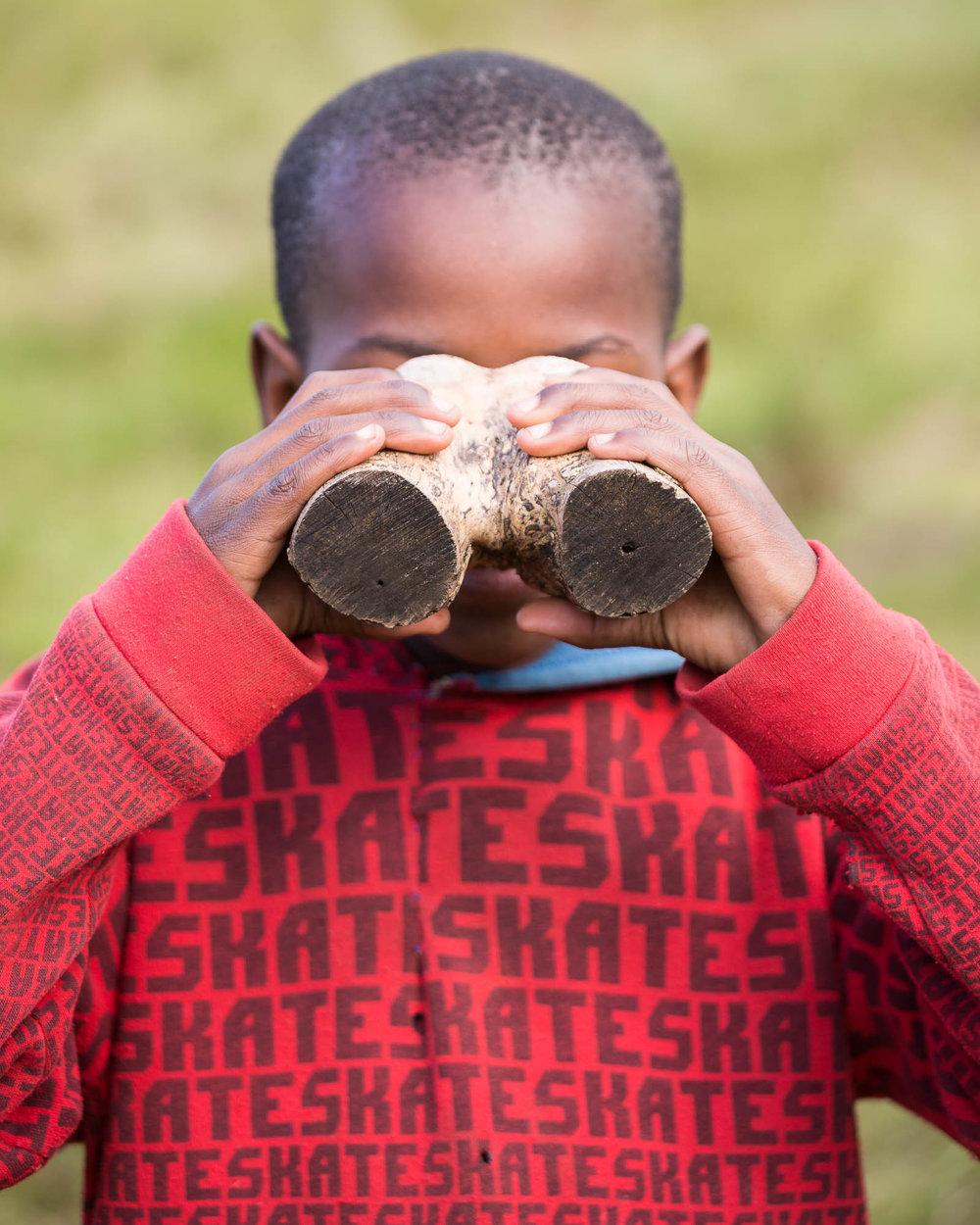 A Magwa Falls 'guide' sporting a set of faux binoculars.