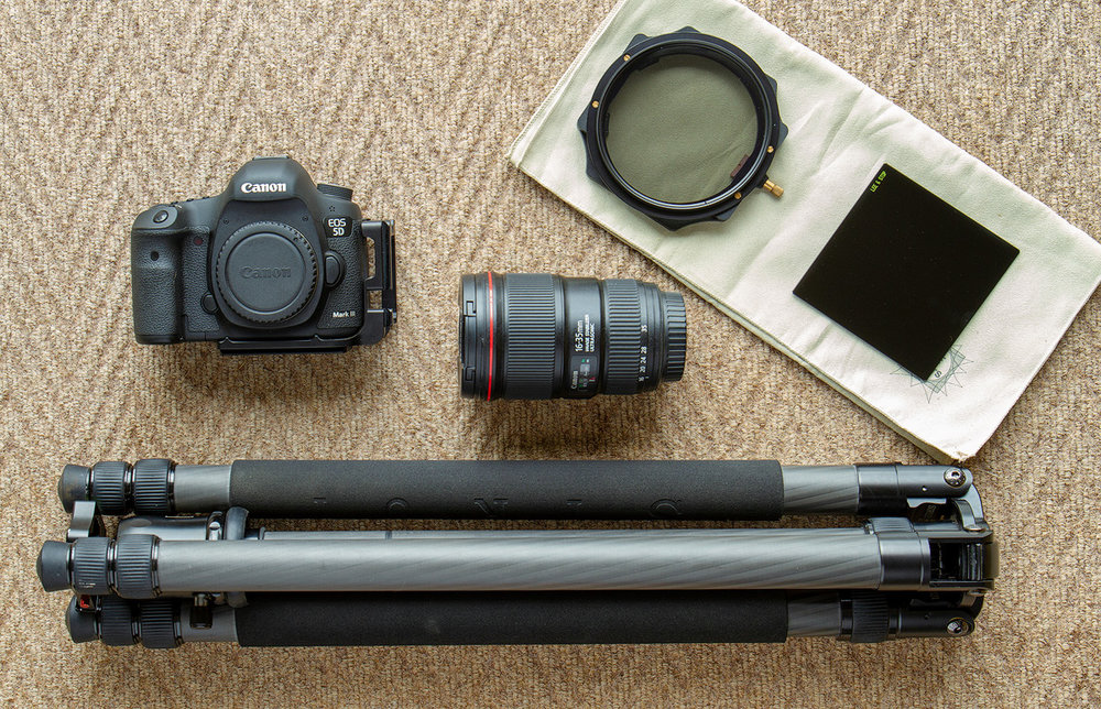 My bare minimum –  (clockwise) A Canon 5d Mk iii, EF 24-70mm f/4L IS USM, Lee Circular Polarising Filter, Lee Little Stopper ND Filter and a Sirui N-3203X Tripod with Sirui K-30X Ball Head.