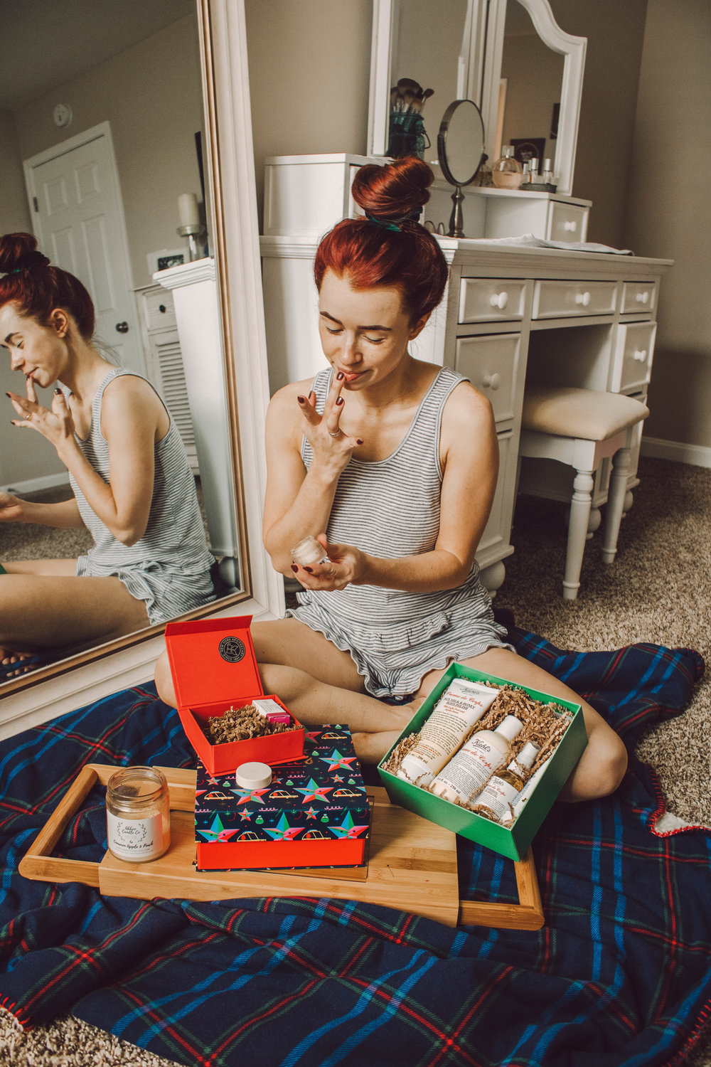 Beauty Gift Ideas with Kiehl's at The Fashion Mall, featured by top Indianapolis beauty blog, Trendy in Indy: image of a woman opening Holiday gifts