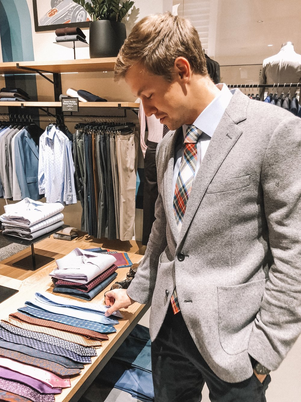 The Best Holiday Gifts for Men with Bonobos featured by top Indianapolis life and style blog, Trendy in Indy: image of a man wearing a gray blazer