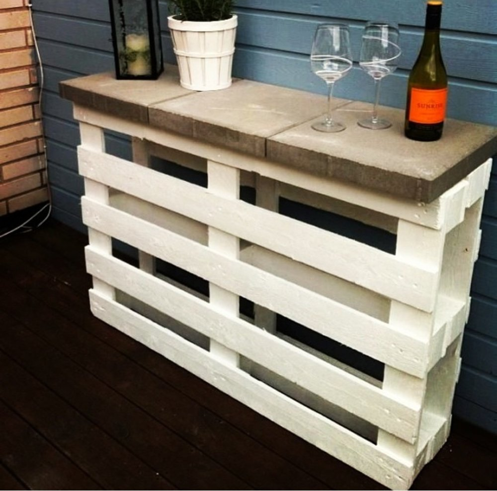 Project #3 DIY Pallet Bar:   Here's another great idea on how to turn pallets into something useful for your outdoor space. Again, sandwich two pallets together and place concrete stepping stones on top as the bar countertops. Awesome addition in hosting your summer parties!