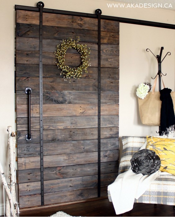 Project #5 DIY Pallet Barn Door:   There are so many great benefits to having a stylish barn door. Barn doors add a lot of character, saves space because you don't have to worry about the door swing and it looks amazing, it's super easy and who cannot forget, it's inexpensive and its made out of pallet wood.  Credit: AKADesign