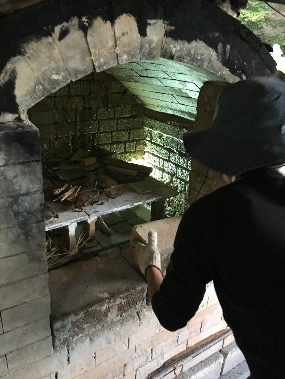 Yoshiko bricking up the door for sealing tomorrow....