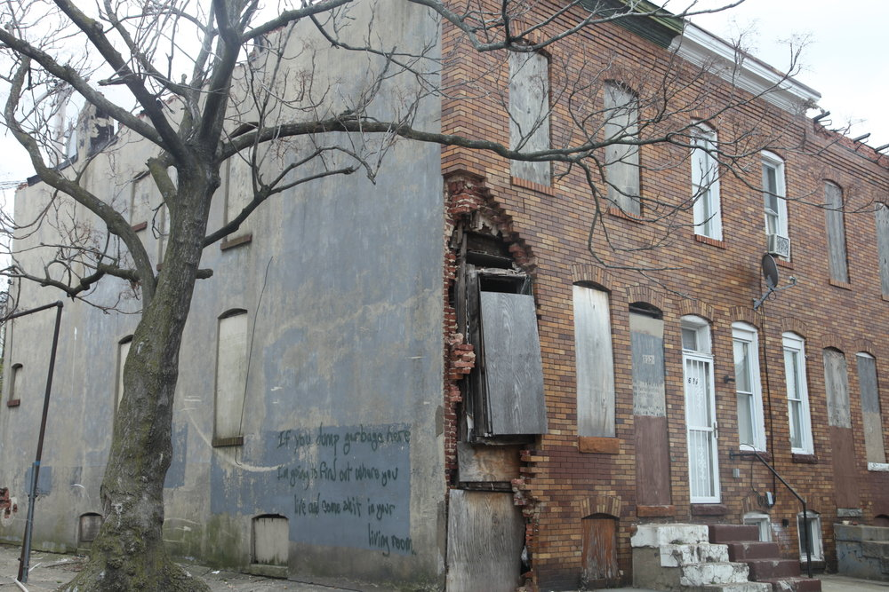 A property near my east side apartment in Baltimore depicts the decay and subsequent consequences vacant houses have on residents.