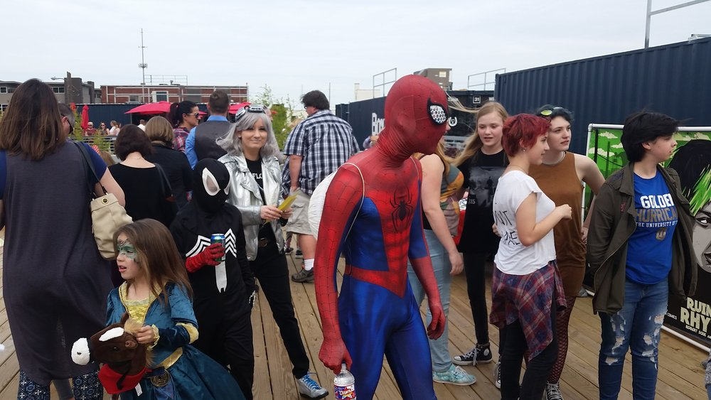 Spider-Man in the crowd.