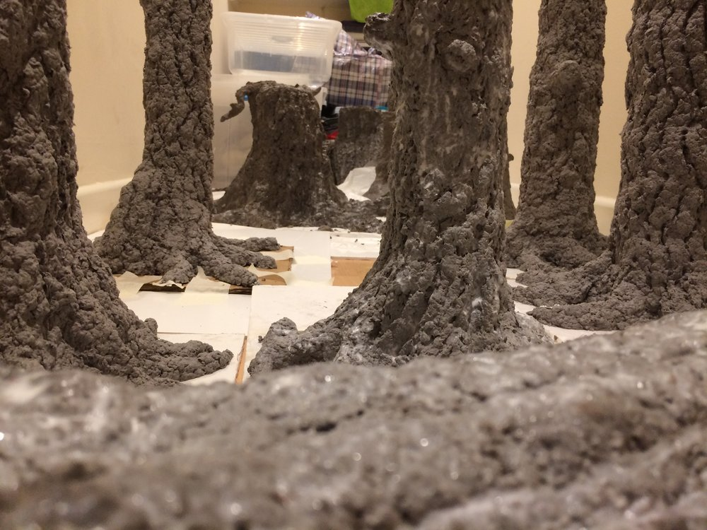 The trees, made from egg boxes, which were made from paper, which came from trees.