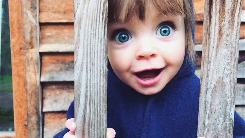 Little girl with big blue eyes smiling