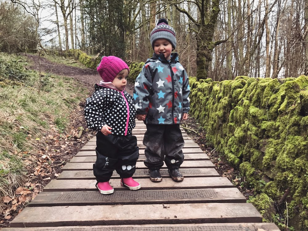 Two toddlers on the boardwalk on Skirrid Mountain.