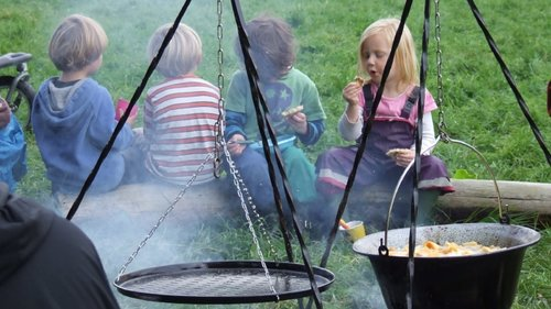 Wild Tots Abergavenny kids eating by the campfire