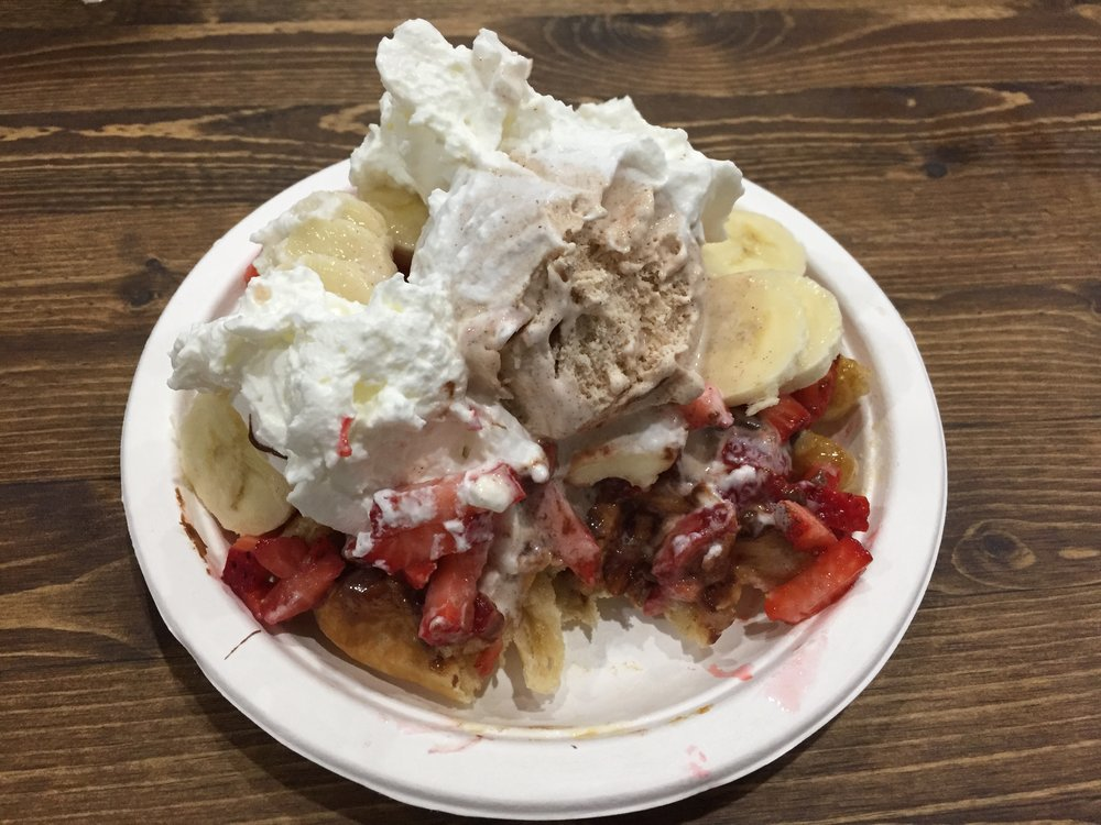 My waffle at Waffallonia, complete with strawberries, bananas, cinnamon ice cream, homemade whipped cream, and Nutella.