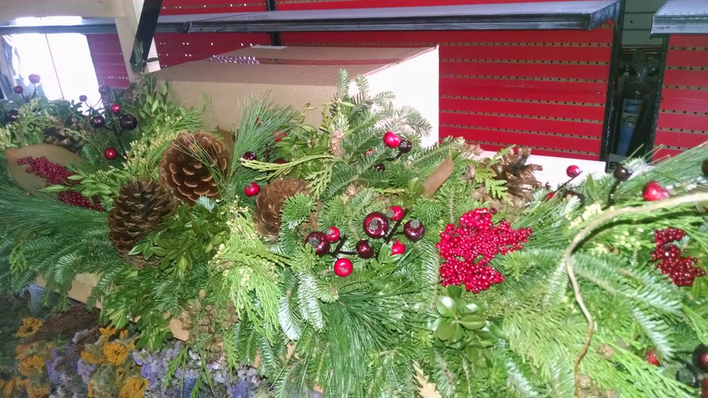M- Mantle piece with reds and pinecones.jpg