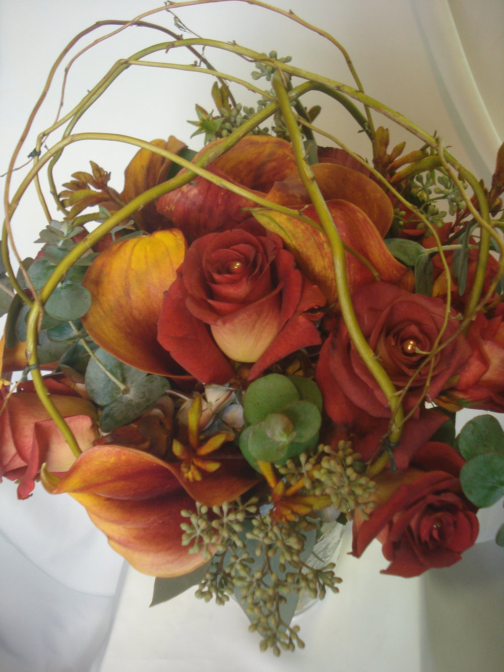 B- Brown roses and calla encased by Curlly willow.JPG