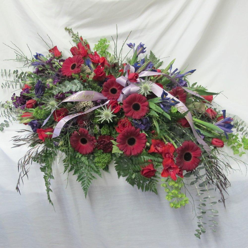 C- Red gerbera and blue irises.jpg