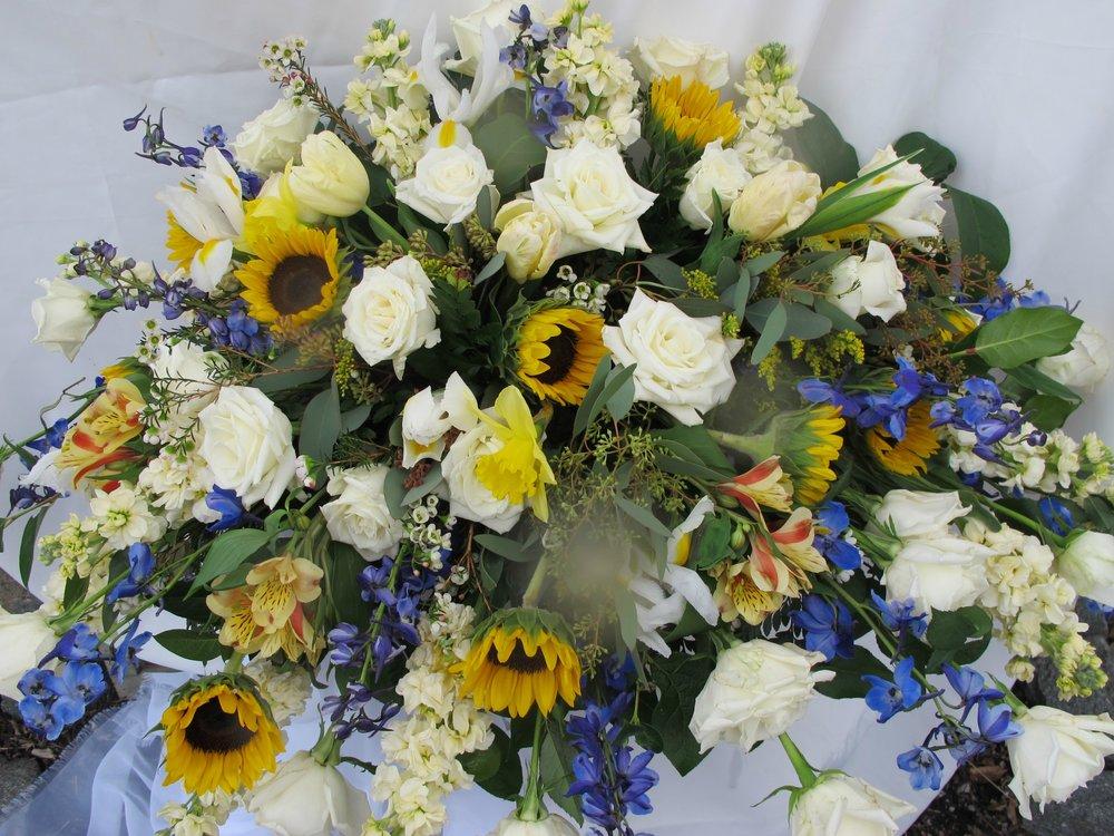 C- Sun flowers, cream roses and blue delphinium.jpg