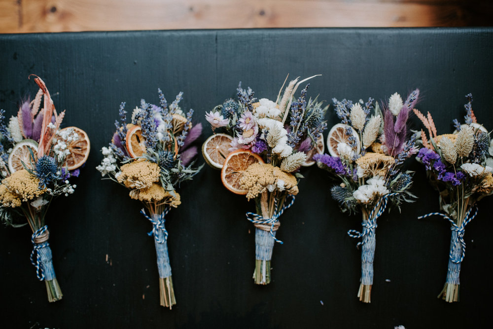 Dried flower bouquets for the bride and her bridesmaids. This bride had planned an intimate wedding celebration in Shoreditch, London.