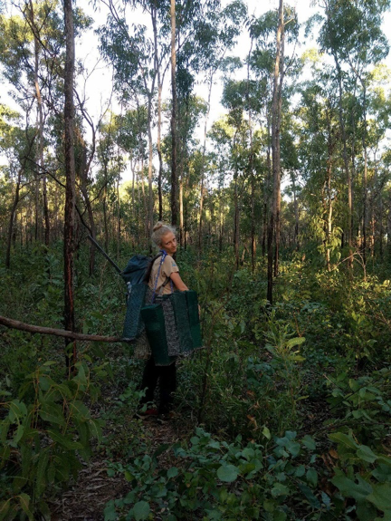 The impressed face of Ellie crying traps in the field at an open woodlands site.