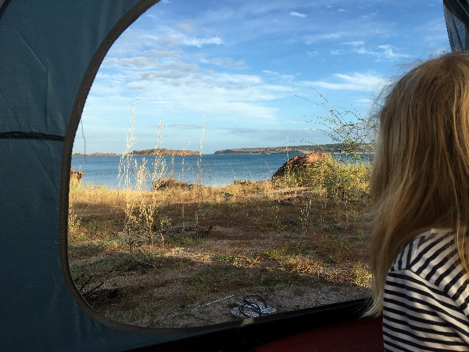 Hannah watching the sunrise from our tent - camping at Marble Point (Hanging Rock). This was our first sleep in in 3 weeks - Bliss!
