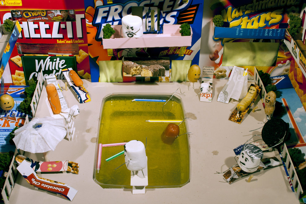 The Vacation    Vacation  is part of two part series ( Poolside  included) that focuses on the impact of the food industry on our lives. Both  The Vacation  and  Poolside  focus on the representation and extent of that relationship. People are represented by food items to symbolize the grip on our lives and we as America have come to be identified with. Both take place at a 'resort', in places where people tend to gather.