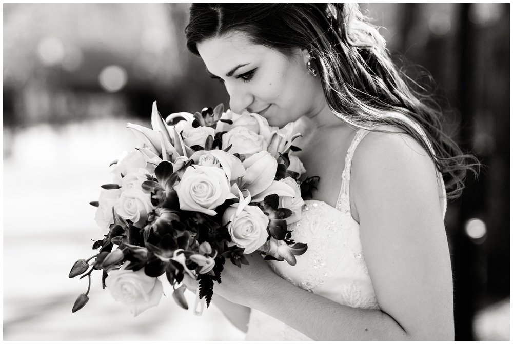 bride smelling her bouquet in Chicago's olive park