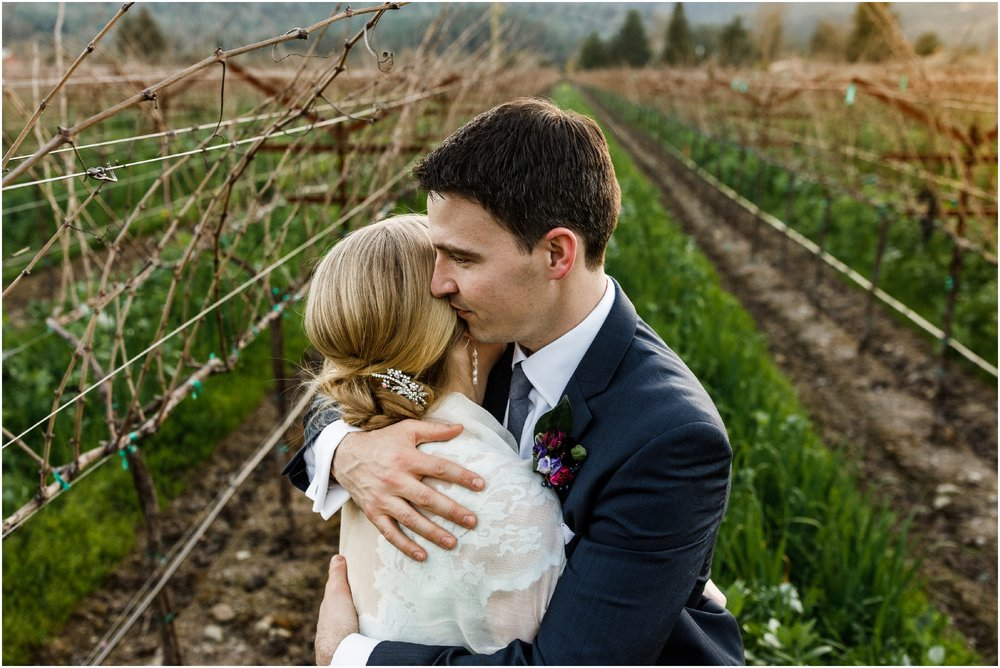 bride and groom embracing in the vineyard at the Harvest Inn