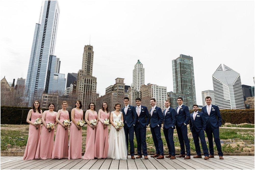 wedding party posing in Millennium park's Lurie garden