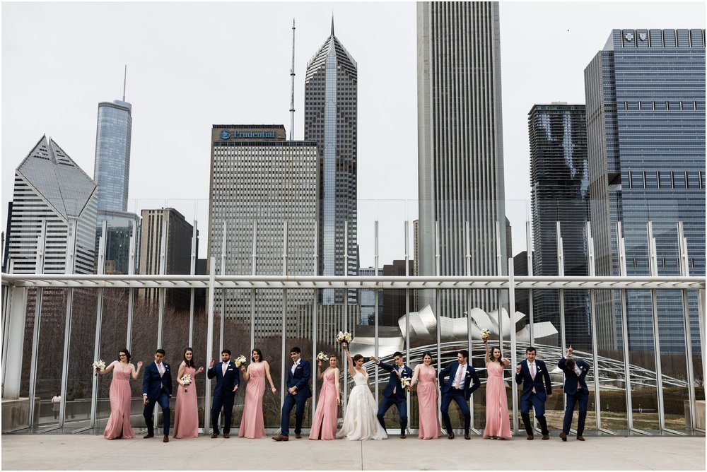 wedding party dancing in front of Millennium park